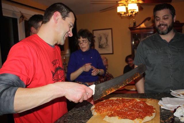 Tony wields his mega pie knife to slice up the sausage pie