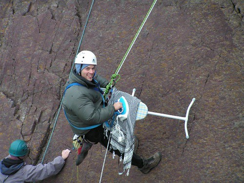 Extreme Ironing While Rock Repelling