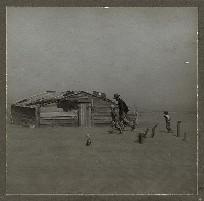 Farmer and sons walking in the face of a dust storm. Cimarron County, Oklahoma (LOC)