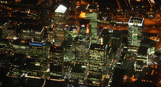 Canary Wharf By Night From The Air, London, England.