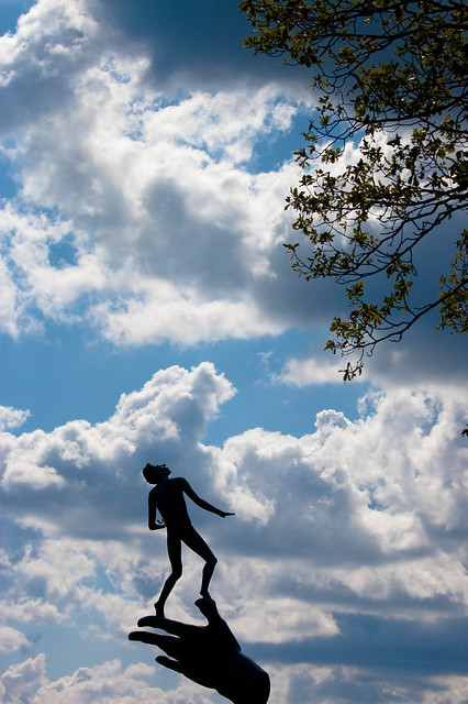 Image of a man scaling the clouds