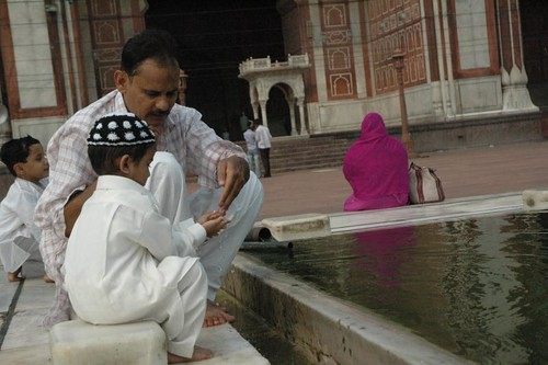 A few with young ones, choose to offer prayers after the crowd disperses