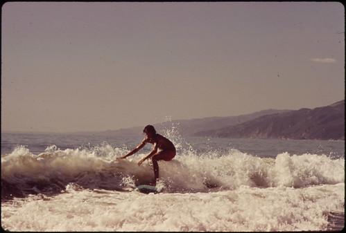 Surfing Along Malibu Beach, California. 10/1972