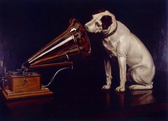 "Dog Looking at and Listening to a Phonograph, ""His Master's Voice"", The Original RCA Music Puppy Dog Logo Symbol for Advertising"