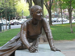 Lucy Stone, sitting on stone