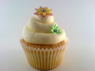Buttercream swirl and flowers on vanilla cupcake
