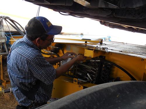 Dad fixing a hydraulic leak