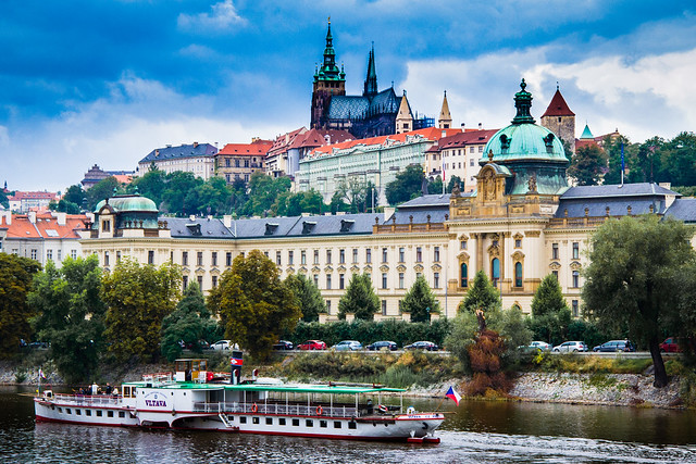 "Prague Castle with ""Vltava"" boat in the river"