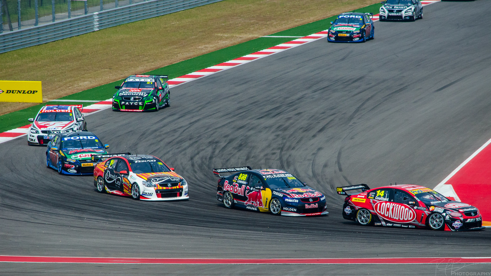 The Pack led by Craig Lowndes and Fabian Coulthard entering Turn 12