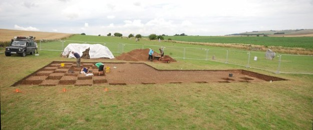 Trench 2 being excavated, with the megalithic avenue in the background and the Aerial Cam landrover