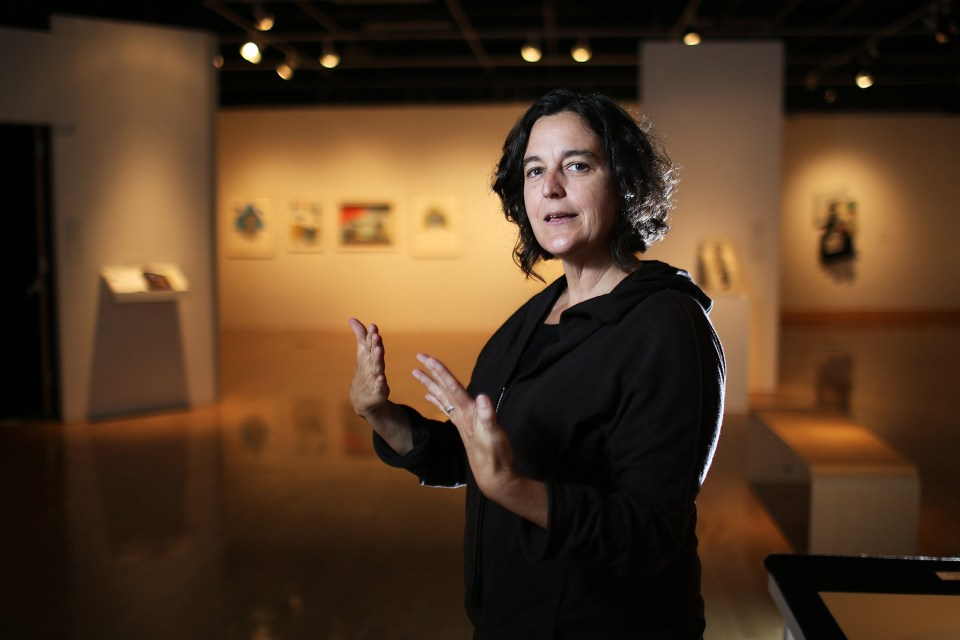 Sharon Bliss, curator for the SF State Gallery of Fine Art, stands in front of the