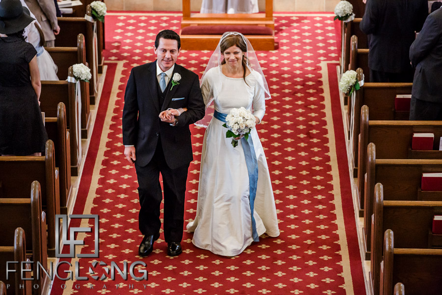 Bride and groom walk down the aisle after the wedding ceremony