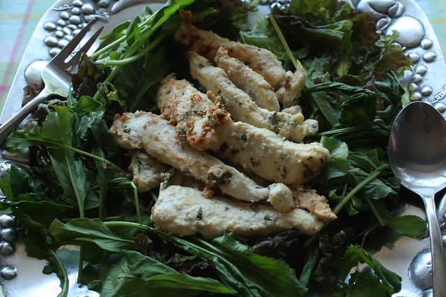 Lemon Thyme Chicken atop mixed arugula