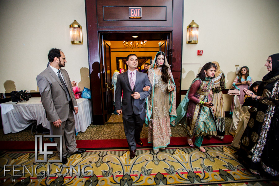 Bride and groom entering hall for Valima