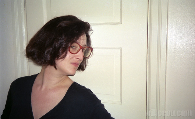 Tina w red glasses