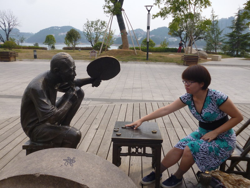 Playing chess with a statue