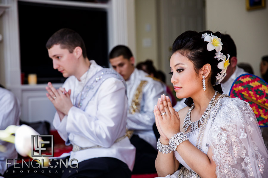 Cambodian bride prays during buddhist ceremony