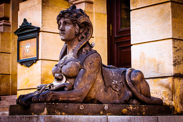 Left Sphinx guarding the Rudolfinum, Prague