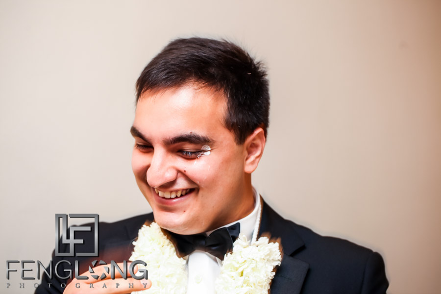 Groom with cake on face