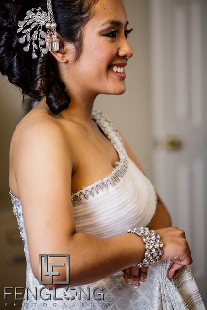 Cambodian bride puts on her Khmer wedding dress before the traditional Cambodian Wedding ceremony