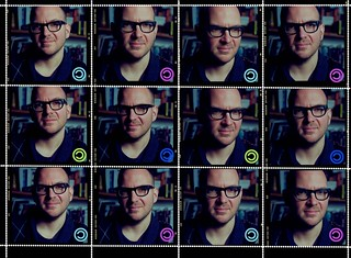 Twelve headshots of Cory Doctorow made to look like postage stamps