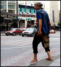 Barefoot Walking On Sidewalk