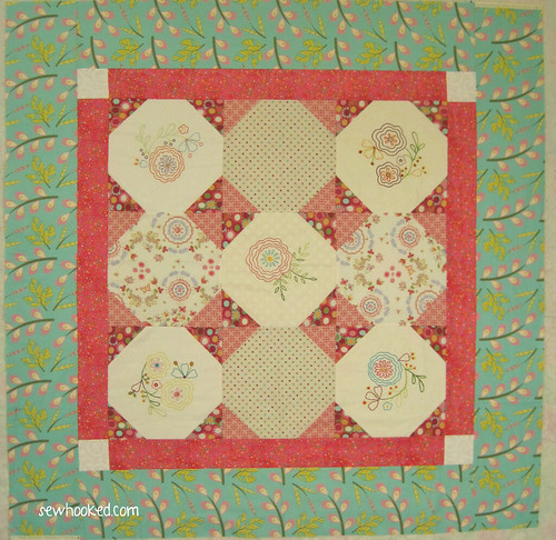 Hand embroidered flower quilt