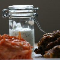 cauliflower fritters, spicy carrot salad & lime sauce