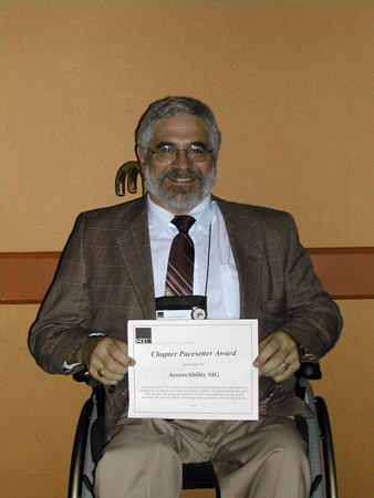 Honors Banquet Reception: Fabien Vais with the AccessAbility SIG 2005 Pacesetter Award certificate.