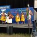 Hawaii Community College Associate Professor Taupori Tangaro, wife Kekuhi Kanahele and their ohana share Hawaiian oli and hula with Smithsonian Folklife Festival audiences.