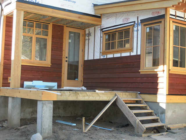 Feb 9 - more progress on the siding. LOVE it!