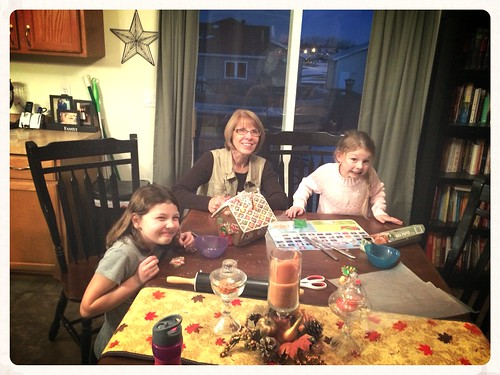 Decorating a gingerbread house with grandma!