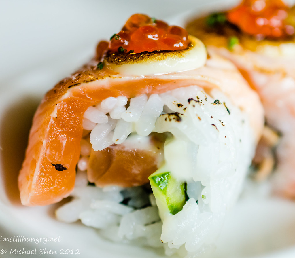 Sushi E Atlantic Roll - salmon, cucumber and chives all rolled I/O then smothered with juicy salmon, salmon roe and mayo.