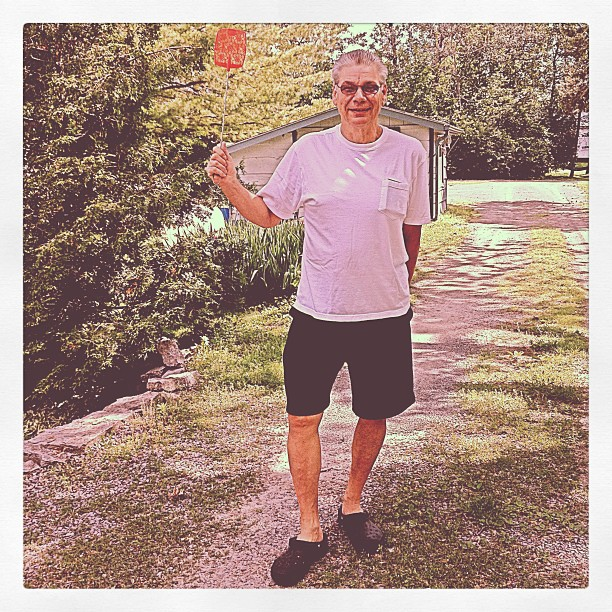 June 30 - license {hubby; licensed to kill; armed with his trusty fly-swatter} #photoaday #license
