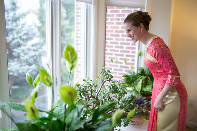 Looking out the window as the groom's family arrives. Katarina Price Photography.