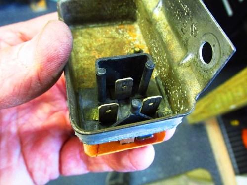 Bottom of Voltage Regulator Housing Showing Where Plug Fits