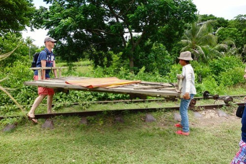 Lifting the platform - Bamboo Train in Battambang, Cambodia