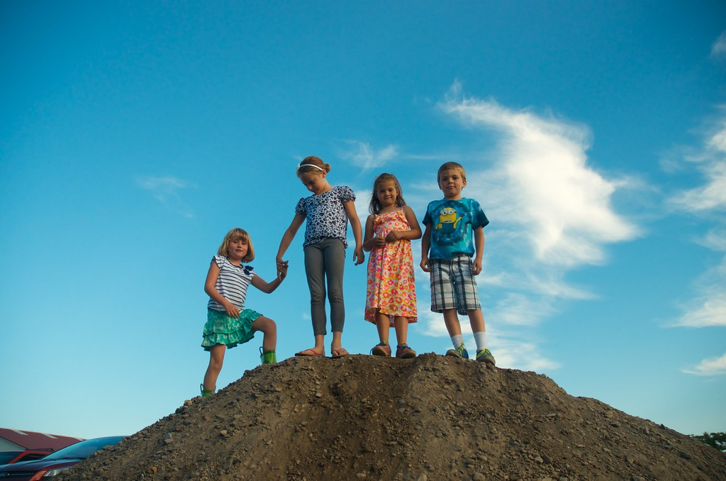Kids on a gravel pile