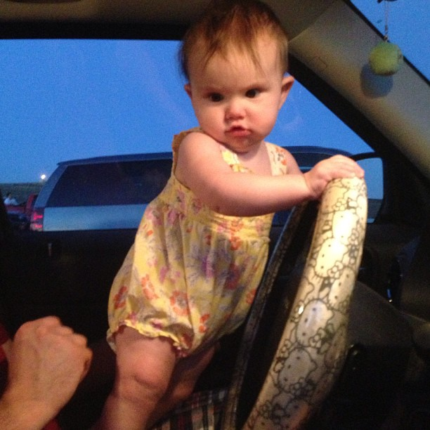 Last night at the drive in, Evey wanted to learn to drive.
