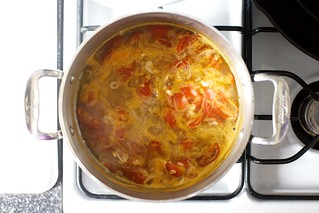 as it simmers, a tomato-onion-garlic broth forms