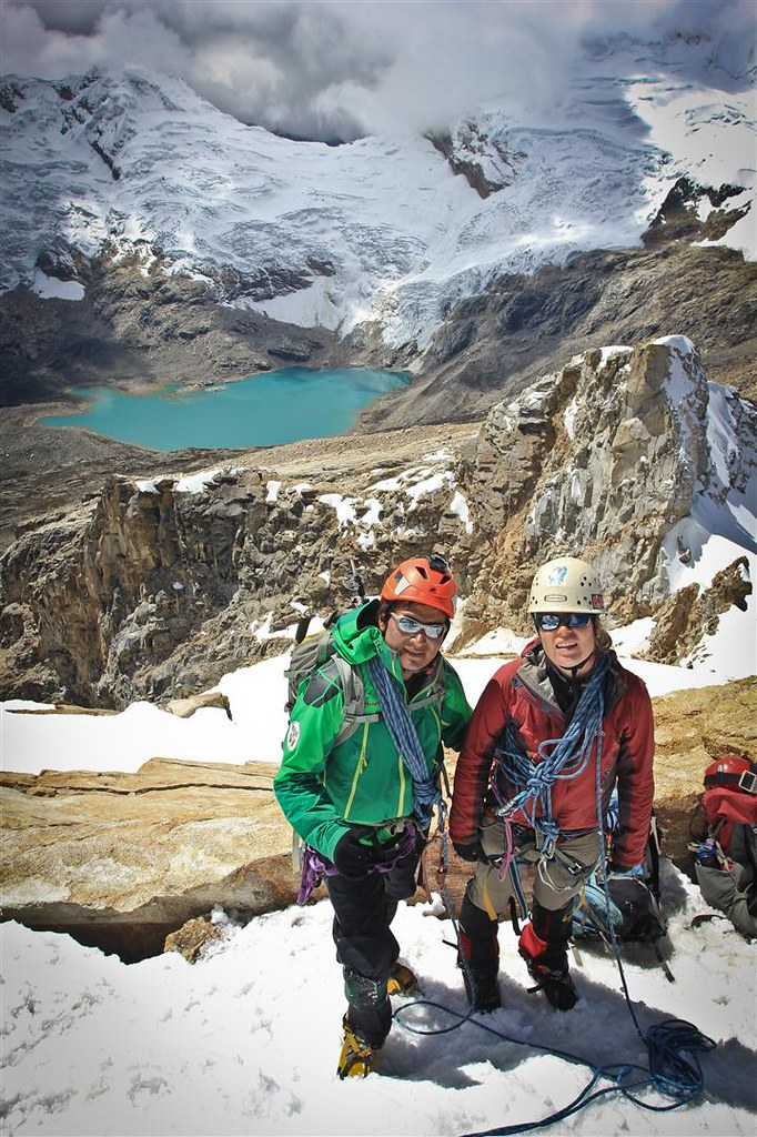 Amigo Roger and Katrijn on the summit of Urus Este(5420m). Azure Laguna Akilpo below. Cordillera Blanca. Peru.