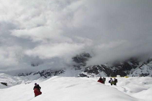 Hauling packs to the landing pad. South Inylchek Glacier Trek