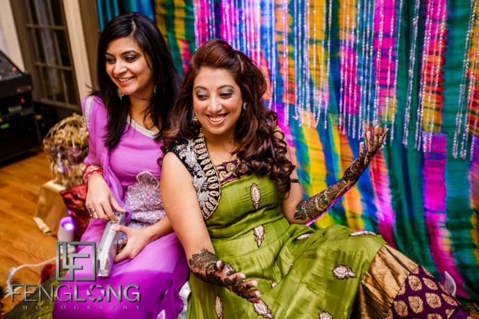 Bride and bridesmaid during mehndi night