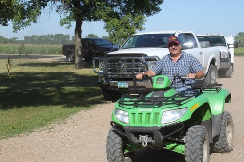 Dad cruising around the farm.