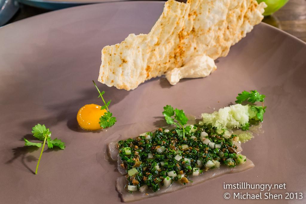 Spanish mackerel carpaccio w/salad burnette, mackerel mousse, prawn cracker & quail yolk Tomislav
