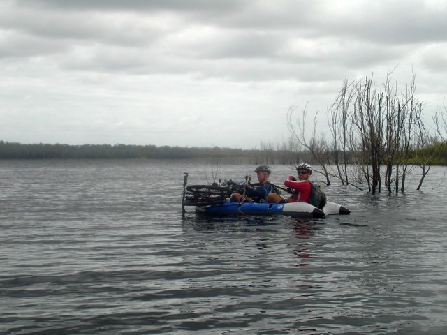Two Mountain Bikers in a Boat