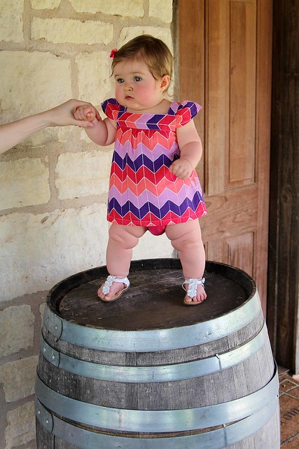 Baby on a wine barrel