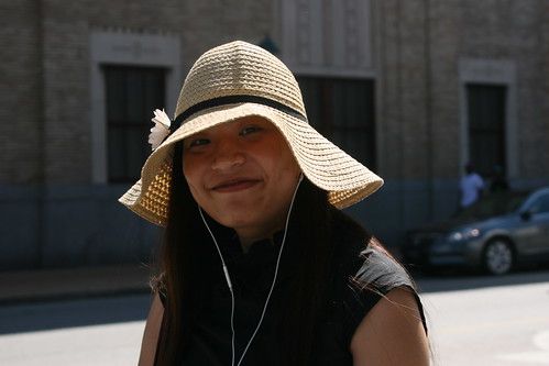 Woman with White iPhone Headphones and a hat