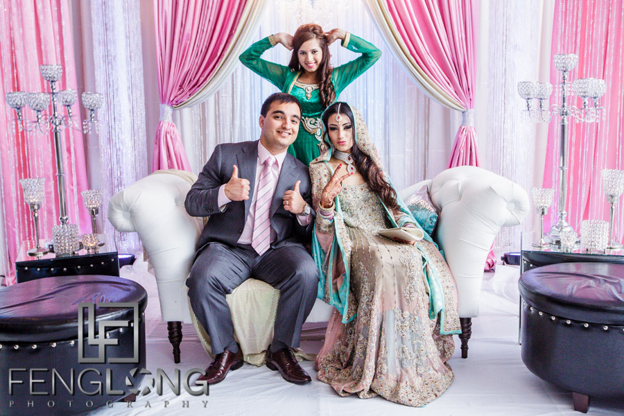 Jennifer and Basit take Valima photos with guests