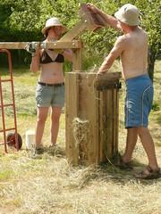 hand baling hay